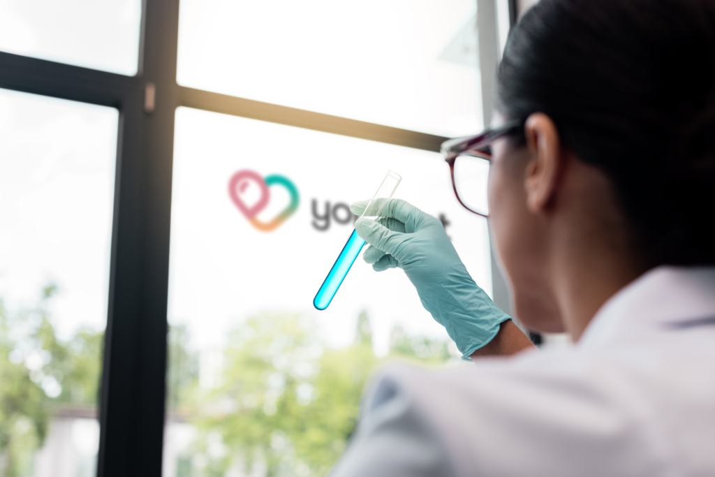 Women holding test tube
