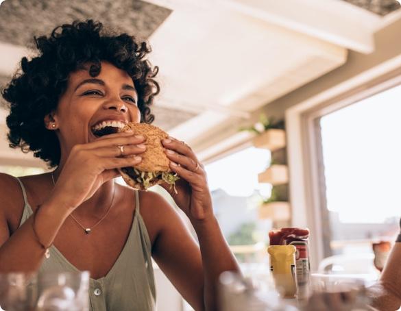 women eating a sandwich